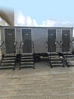 20-ft Shower Trailer with 8 private stalls for rent from Jimmy's Johnnys Inc, Minnesota